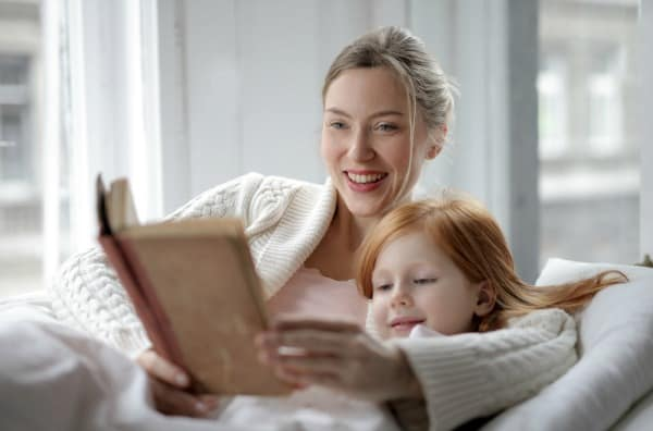 best mom hacks- mom reading to daughter creating a bedtime routine